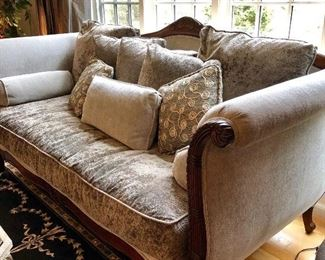 Plush Velvet Sofa with a million matching cushions. Super deep for extra coziness factor! Shimmering Silver in color.