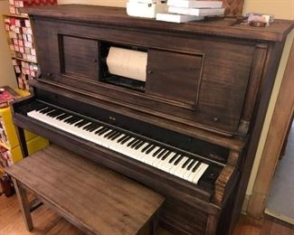 Beautiful played piano with lots of music rolls