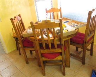 Table loaded with Kitchen Tools & Cutlery