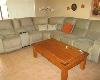 Like-New 3 Piece Sectional by Ashley Furniture.  Barely 2 years old and a beautiful unit!  Reclining Sections and a Suede-Like Pewter Color Upholstery.  Overall Size:  10' X 10'