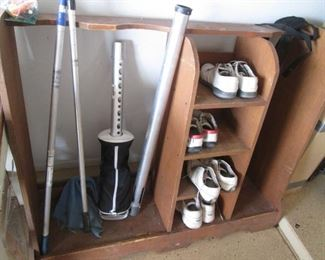 Cabinet designed to hold Golf Clubs + Golf Shoes