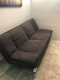 Modern Futon sofa, grey area rug - Purchased at Scandinavian Home