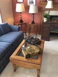Oak dropleaf coffee table with glass (matching end table available); antique side table with marquetry top; small cupboard/side table; table lamps