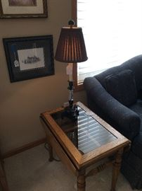 Oak dropleaf end table with glass (matching coffee table available), table lamp, framed art