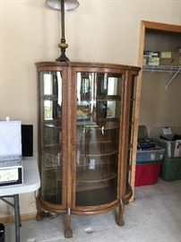 Oak curved glass curio cabinet; perfect for displaying your prized pottery collection, glassware, dishware, or other treasured collections