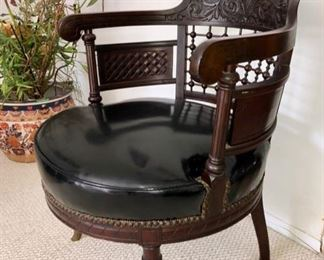 Vintage carved wood & leather chair