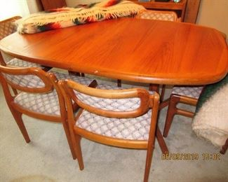 TEAK TABLE AND CHAIRS WITH 2 EXTENSIONS BY DYRLUND MADE IN DENMARK 66X42  EXTENSIONS ARE 20X42
