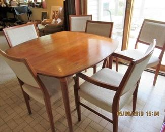 TEAK DINING SUITE 6 CHAIRS AND 2 EXTENSIONS BY SVEGARD MADE IN SWEDEN 42X.42. EXT ARE 18X42