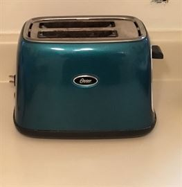 Fashion statement for any kitchen, this Oster Turquoise Toaster