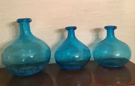 Beautiful matching three bottle turquoise blue. Can purchase as a set or individual.