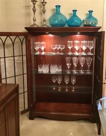 Curio/Bookcase/ Trinket Cabinet displaying beautiful bar glasses , This pic shows the depth of the shelves and highlights the lighting showcasing the beautiful wood grain and glass shelves.