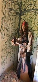 Lifesize cardboard cutout of actor Johnny  Depp as Captain Jack Sparrow in Pirates of the Caribbean.