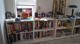 bookcases with books and decor