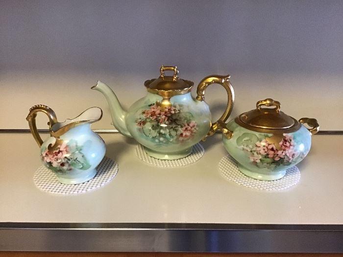 Antique tea pot, creamer & sugar