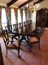 Long formal dining room table (3 pedestals) with 2 removable extension leaves and 14 dining room chairs & china cabinet.