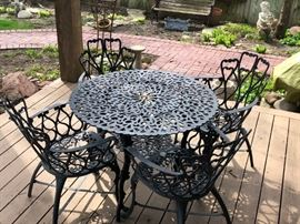 Wrought Iron Table with 6 wrought iron chairs. Additional 2 chairs not pictured.