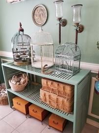 Collection of birdcages, shutter shelves, seashells and baskets