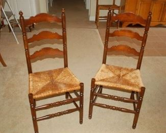 Two of four vintage weaved bottom high back chair