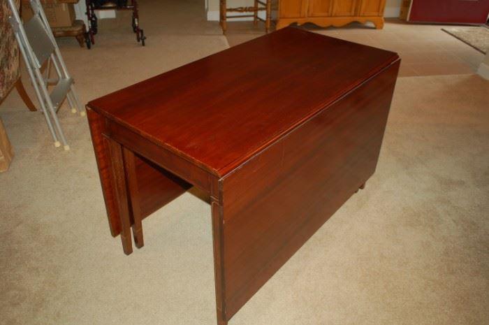 "Brandt mahogany dining room table; 24.5""W x 46""L X 28.5""H"
