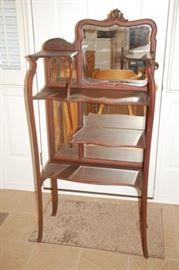 Stunning antique shelf with beveled mirror back