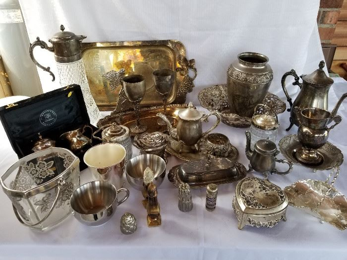 Large collection of vintage silver plated and pewter dining items https://ctbids.com/#!/description/share/136918