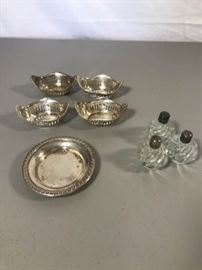Sterling silver ash receiver, 4 individual nut dishes. https://ctbids.com/#!/description/share/137333