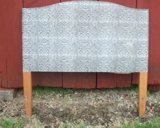 Vintage headboard off of a twin bed.