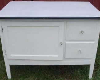 Antique cabinet with enamel top.  Very country kitchen.