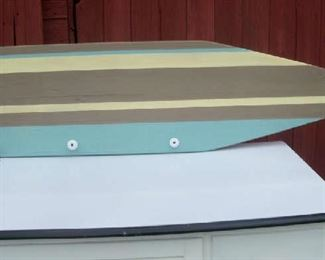 Coat or clothing rack made from a vintage wooden ironing board.