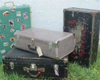 Assortment of vintage suitcases and trunks.  Great decoration and storage.