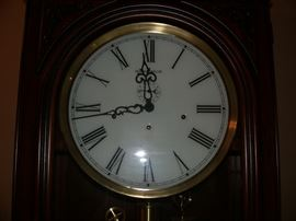 Face of Howard Miller Grandfather Clock