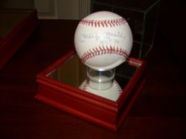 Signed Baseball by Mickey Mantle with paperwork.