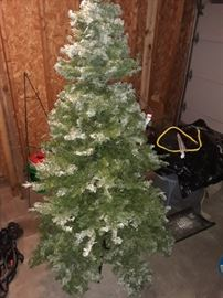 7.5 foot flocked tree. 45.00 or best.