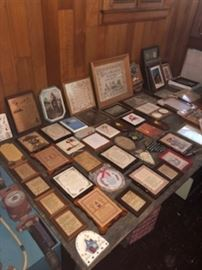 Pictures and plaques, many religious, many brand new.