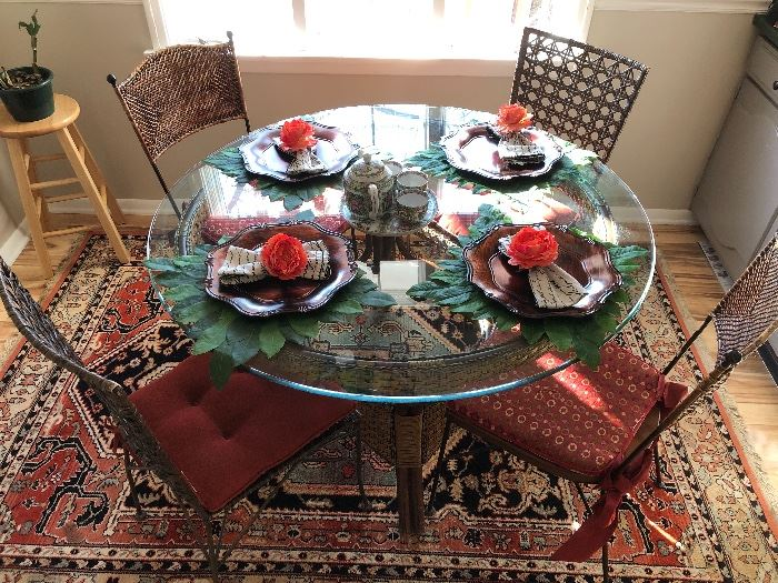 Round glass table with 4 accompanying chairs