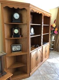 Four-section oak finish display shelves, sold separately or together - $495 (Includes 2 end/corner 5-shelf units - $55 EA, 2 wall units w/3 shelves and lower cupboard - $195 EA)