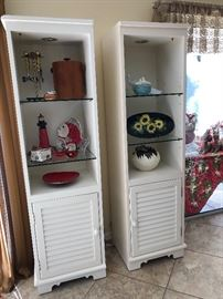 Two white/off-white display shelves w/shutter cupboard doors - $75 EA.