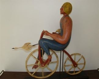 Carved Wooden figure on bicycle by William Jauquet