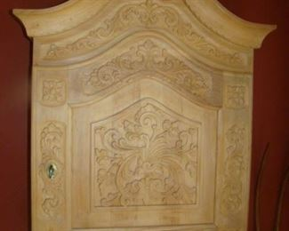 Locking Carved wooden wall cabinet with accessories inside