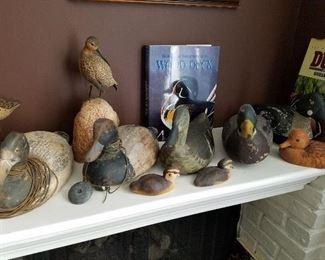 Selection of duck decoys and shore birds