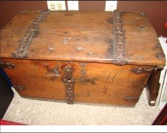 Antique Norwegian ornamental hinged trunk with initials J & H carved on the front.