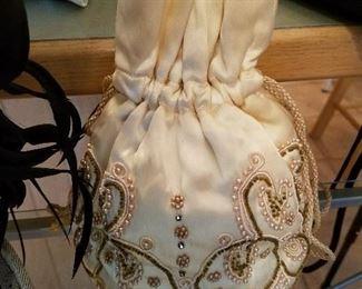 Silk beaded hand bag.