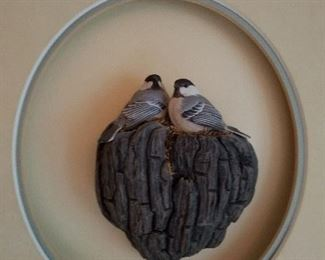 Carved wooden chickadees.