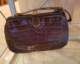 Alligator hand bag.