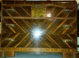 Three drawer inlay waterfall chest has bake-a-lite in handles & is great condition