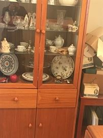 Teak china cabinet filled with Waterford, China & candlestick glassware  Wedgwood & waterford