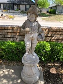 Concrete little boy statute