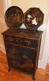Asian lacquered small chest and two chargers, inlaid