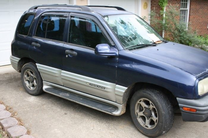 2001 Chevy Tracker. 220,000 miles.  4WD works.  Owned by Mechanic. Runs and drives Great.  Dependable!  $1500