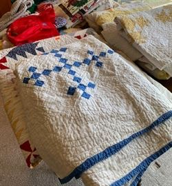 numerous vintage quilts